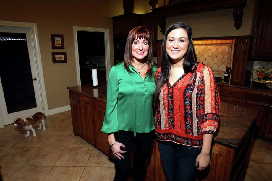 Rose Mary Robert and her daughter Maggi in their kitchen in their home on Boerne. Photo: Helen L. Montoya, SAN ANTONIO EXPRESS-NEWS / SAN ANTONIO EXPRESS-NEWS