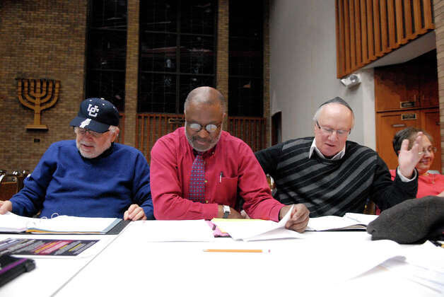 Paul Bashan, left, Laconia Therrio and Geoffrey Kirshner read through a script as the theater group Jewish Arts Alive works on new material at Congregation Agudath Sholom in Stamford, Conn., Dec. 27, 2012. Tamar Gershberg is the founder and director of the group. She is hoping to revive the organization, which is dedicated to promoting, educating, and exploring the rich tapestry of Jewish heritage and folklore through the arts, and is predicated on working with multi-cultural entities in order to build bridges of understanding in the community. Photo: Keelin Daly / Stamford Advocate Riverbend Stamford, CT