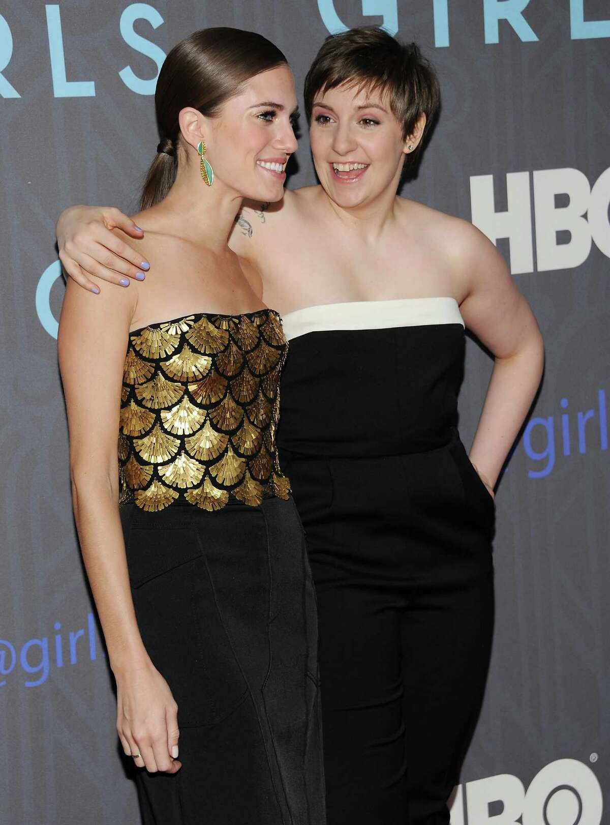 Actresses Allison Williams, left, and Lena Dunham pose together on the red carpet at the HBO premiere of
