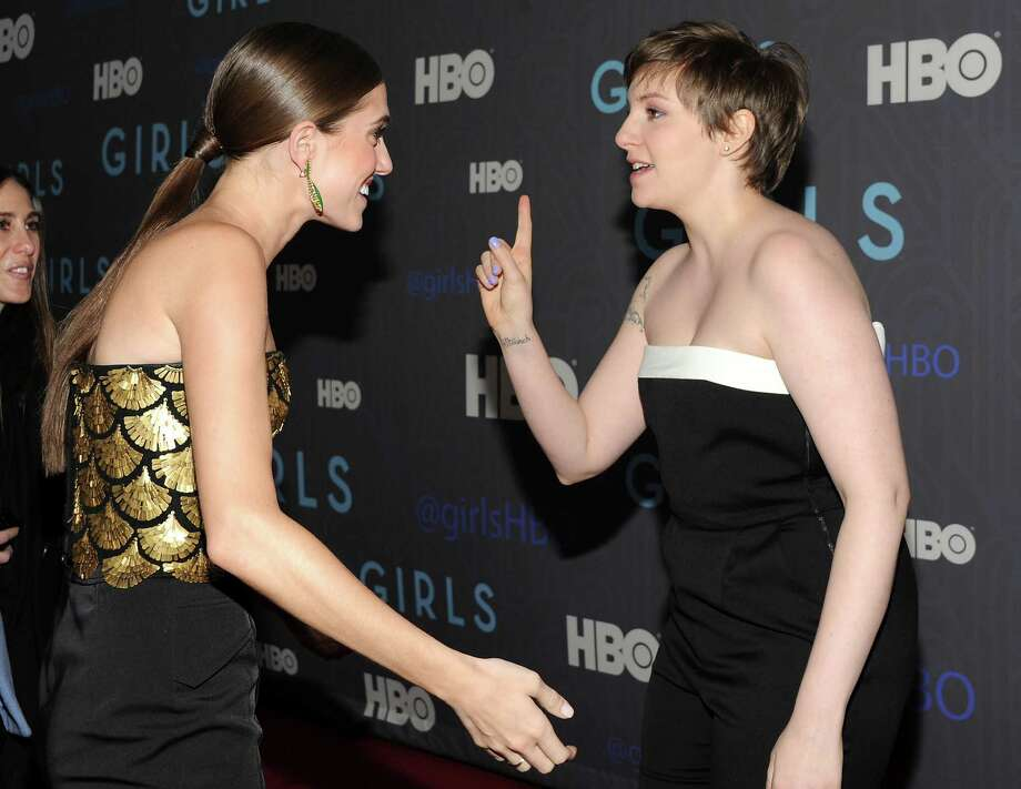 "Actresses Allison Williams, left, and Lena Dunham greet each other on the red carpet at the HBO premiere of ""Girls"" at the NYU Skirball Center on Wednesday, Jan. 9, 2013 in New York. Photo: Evan Agostini, Evan Agostini/Invision/AP / Invision"