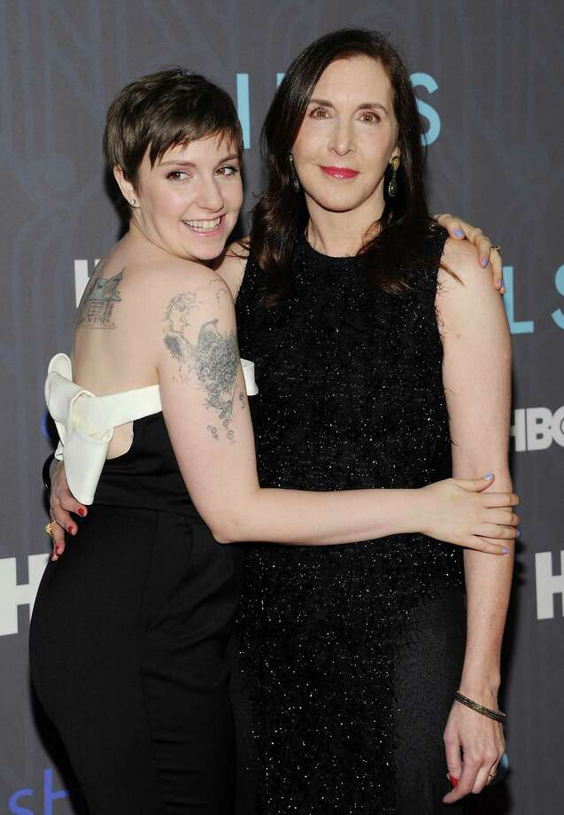 "Creator, executive producer and actress, Lena Dunham, poses with her mother, Laurie Simmons, at the HBO premiere of ""Girls"" at the NYU Skirball Center on Wednesday, Jan. 9, 2013 in New York. Photo: Evan Agostini, Evan Agostini/Invision/AP / Invision"