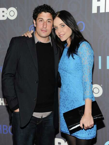 Actor Jason Biggs and wife Jenny Mollen attend the HBO premiere of