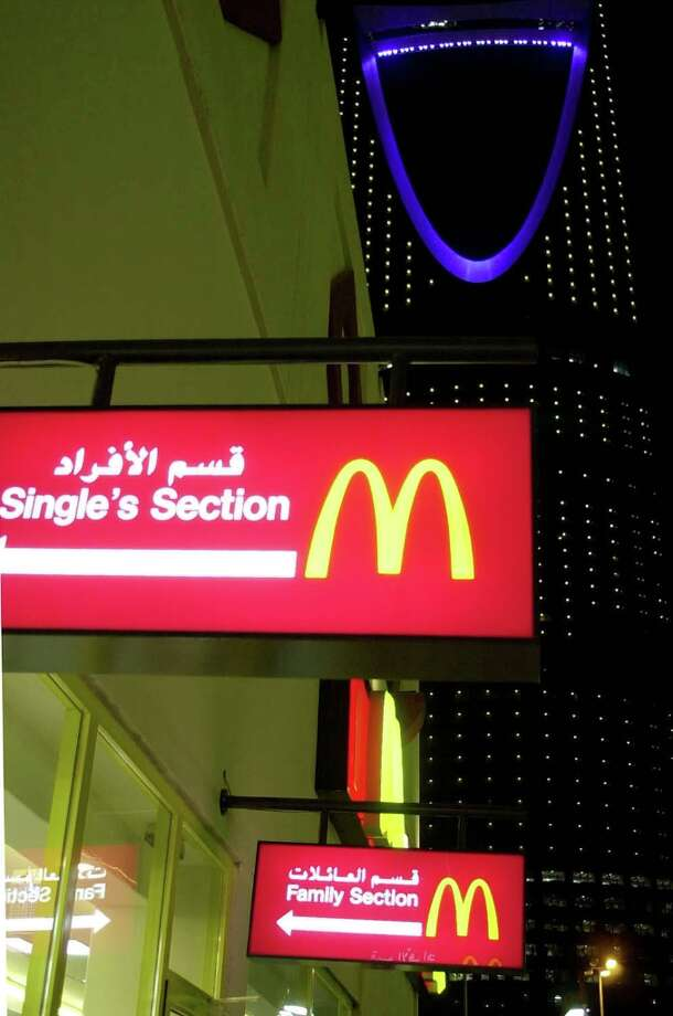A McDonald's restaurant in downtown Riyadh, Saudi Arabia, avoids improper mixing of the sexes with a singles' section for men alone or with other men and a family section for families and women alone or with their children and other women. (Associated Press) Photo: HASAN JAMALI, AP / AP
