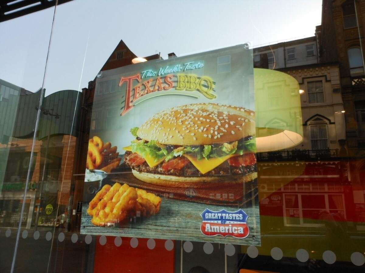A window sign for the Texas BBQ Burger at a McDonald's in London.