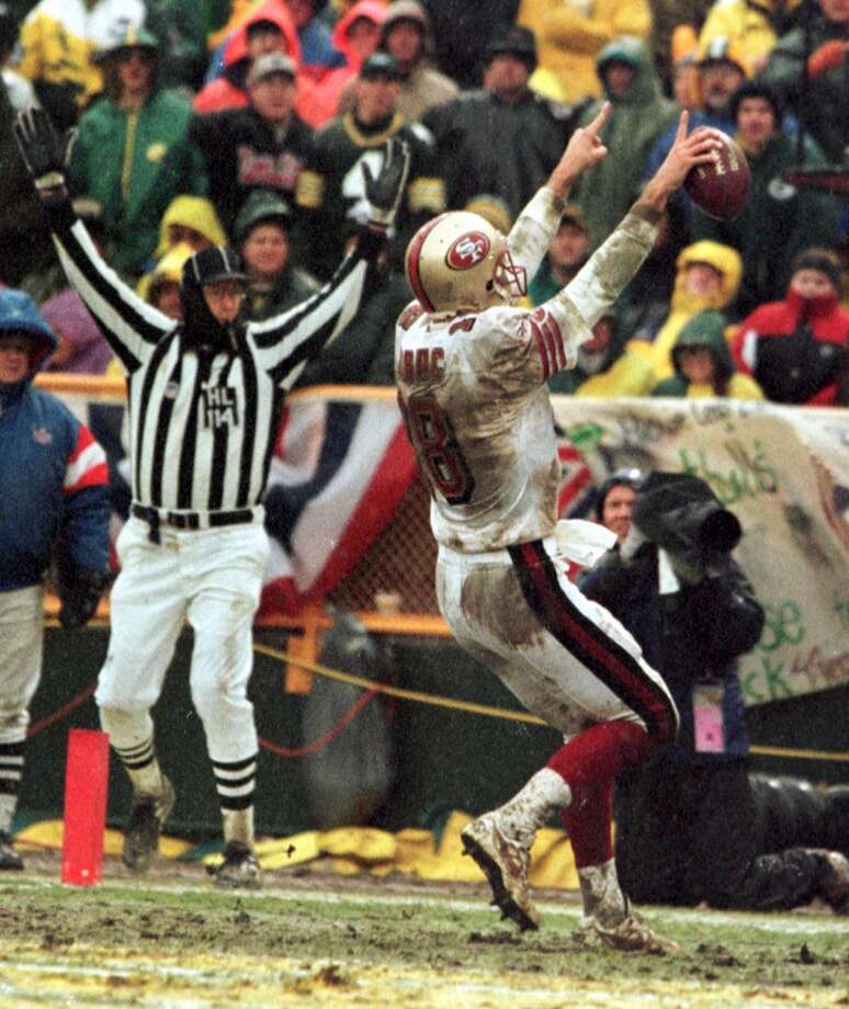 1997: Elvis Grbac celebrates his bootleg touchdown run in the third quarter. Photo: MICHAEL MALONEY / ONLINE_YES