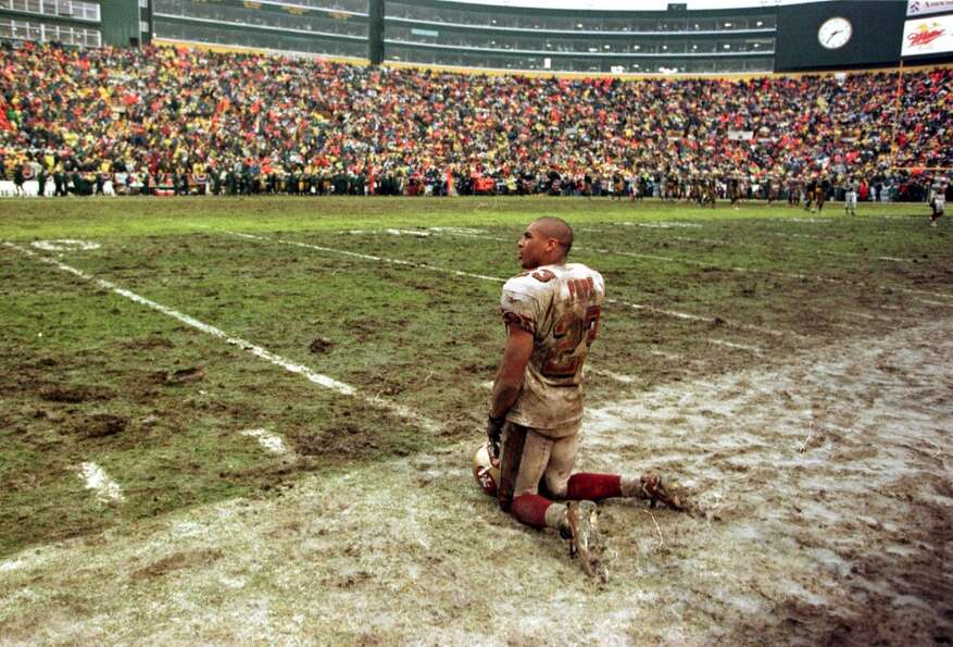 1997: Marquez Pope kneels on muddy Lambeau Field and watches time run out for the Niners in the clos