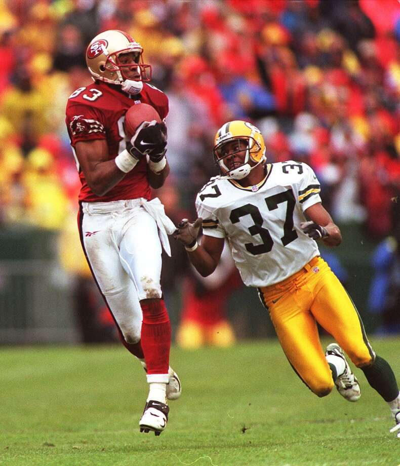 1998: 49ers wide receiver J.J. Stokes pulls in the ball in the second quarter while Tyrone Williams tries to chase him down. (Michael Macor / The Chronicle) Photo: MICHAEL MACOR, STAFF / ONLINE_YES