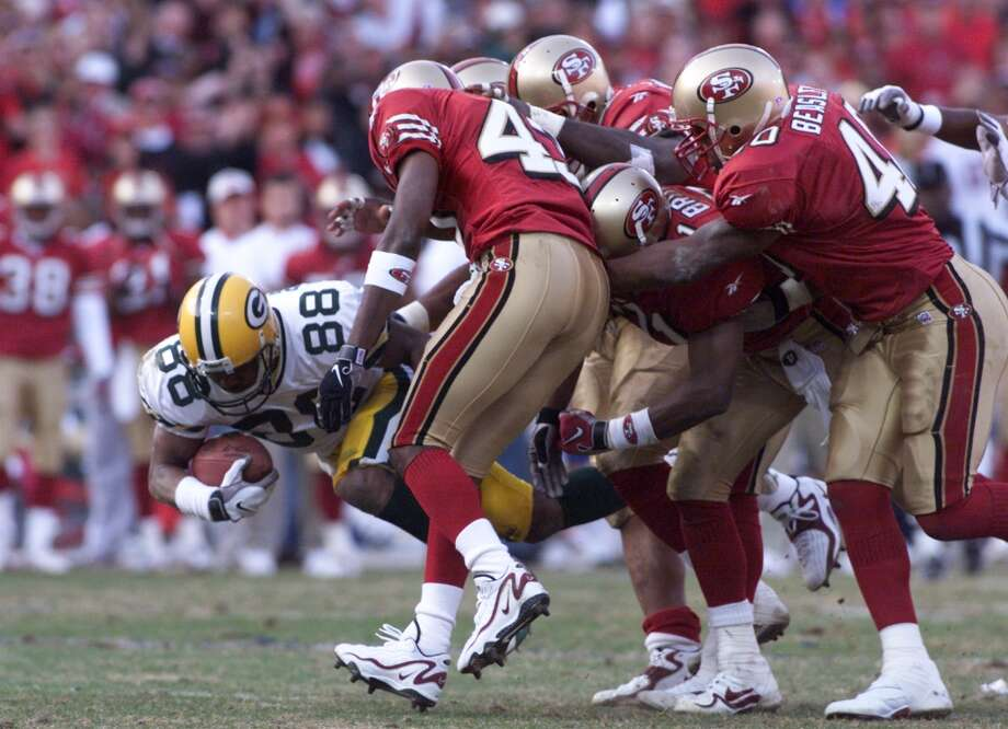 1999: Packer Roell Preston is taken down by a host of tacklers in the fourth quarter. (Michael Macor / The Chronicle) Photo: MICHAEL MACOR, SFC / ONLINE_YES