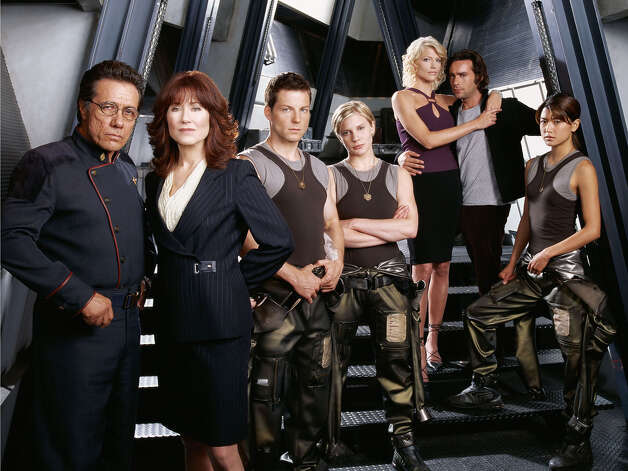"Edward James Olmos, Mary McDonnell, Jamie Bamber, Katee Sackhoff, Tricia Helfer, James Callis and Grace Park (from left) in ""Battlestar Galactica."" Photo: Network - SCI FI Channel / Filename - BSG04_039FORF"