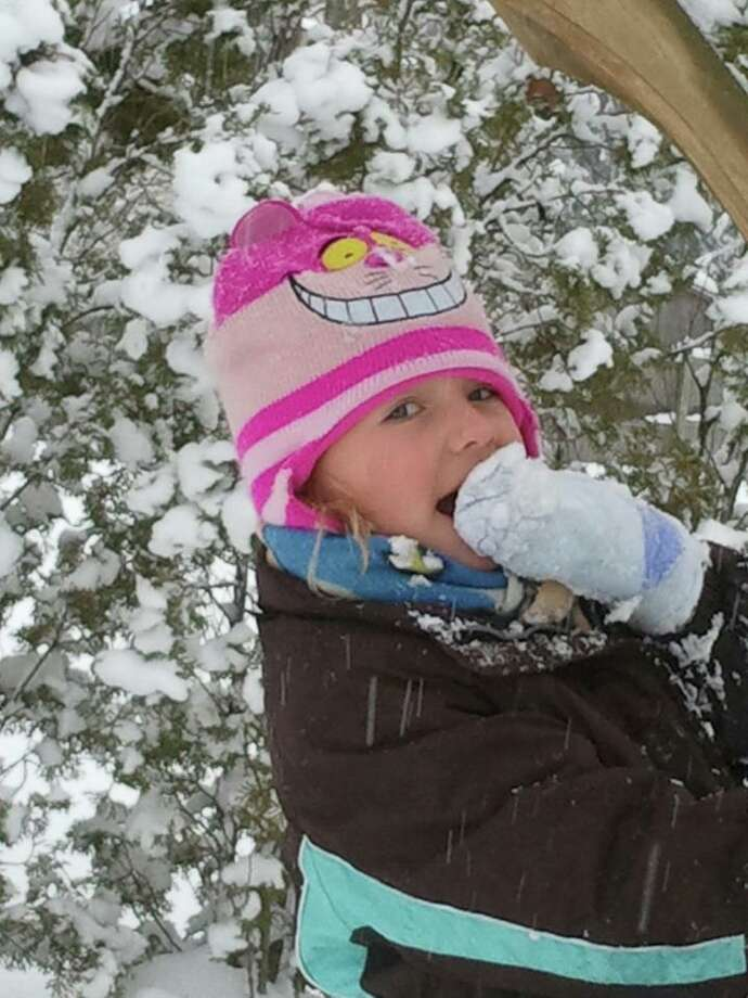 That fresh taste of snow is one of the benefits of winter. Six-year-old Bella Calina Rozycki gets her first taste of the stuff in Glenville while playing in the woods earlier this season. (Toni Atchinson-Rozycki)