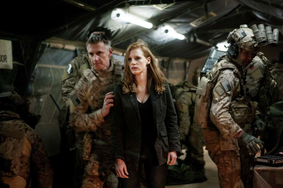 Stationed in a covert base overseas, Jessica Chastain (center) plays a member of the elite team of spies and military operatives (Christopher Stanley, LEFT and Alex Corbet Burcher, RIGHT) who secretly devoted themselves to finding Osama Bin Laden in Columbia Pictures' electrifying new thriller directed by Kathryn Bigelow, ZERO DARK THIRTY. Photo: AP
