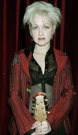 "Cyndi Lauper poses for a photograph after performing songs from her new album, ""The Body Acoustic,"" during a press preview, Oct. 6, 2005.  (AP Photo/Diane Bondareff) Photo: DIANE BONDAREFF, Associated Press / AP"