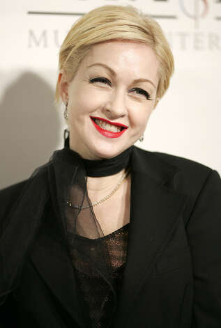 Cyndi Lauper arrives to a Sony BMG Music Entertainment Grammy Party in a Los Angeles file photo from Feb. 13, 2005.  (AP Photo/Chris Polk, File) Photo: CHRIS POLK, Associated Press / CHRIS POLK