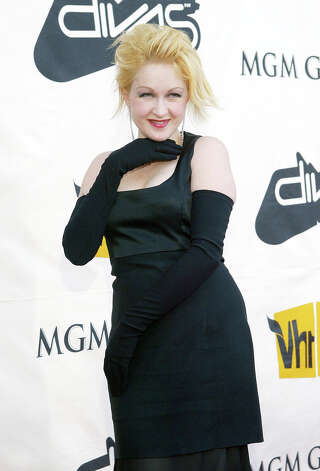 Cyndi Lauper arrives on the red carpet during The VH1 Divas Live concert Sunday, April 18, 2004 at the MGM Grand Garden Arena in Las Vegas. (AP Photo/Eric Jamison) Photo: ERIC JAMISON, Associated Press / AP