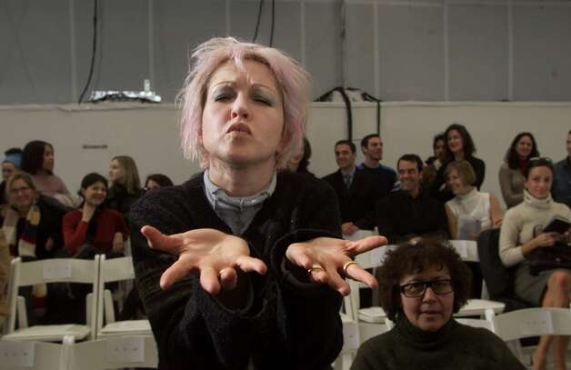 Singer Cyndi Lauper poses for photographers before the start of the Helmut Lang Fall 2000 fashion show Thursday, Feb. 10, 2000, in New York.(AP Photo/Kathy Willens) Photo: KATHY WILLENS, Associated Press / AP