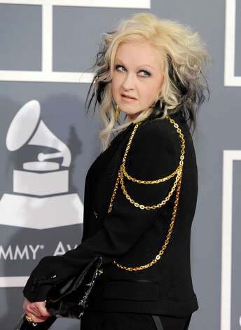 Cyndi Lauper arrives at the 54th annual Grammy Awards on Sunday, Feb. 12, 2012 in Los Angeles. (AP Photo/Chris Pizzello) Photo: Chris Pizzello, Associated Press / AP