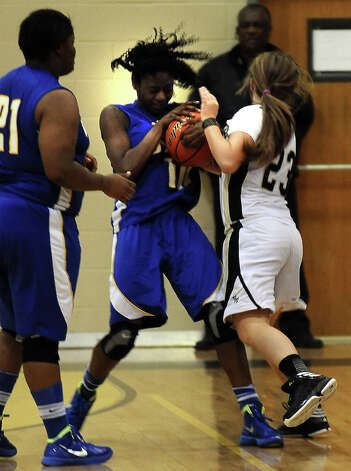Lady Pirate Amber Jacks, #23, and Lady Panther SanQueisha Rawls, #10, scrap for the ball during the Vidor High School Lady Pirates basketball game against the Ozen High School Lady Panthers on Tuesday December 21, 2012, at Vidor High School. Ozen won over Vidor 64 - 58. Photo taken: Randy Edwards/The Enterprise Photo: Randy Edwards