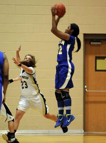 Lady Panther Alexandra Moten, #32, puts it up for two during the Vidor High School Lady Pirates basketball game against the Ozen High School Lady Panthers on Tuesday December 21, 2012, at Vidor High School. Ozen won over Vidor 64 - 58. Photo taken: Randy Edwards/The Enterprise Photo: Randy Edwards