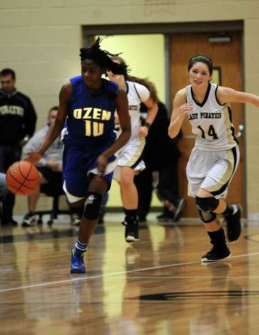 Lady Panther SanQueish Rawls, #10, steals the ball from Lady Pirate Blair Richmond, #14, during the Vidor High School Lady Pirates basketball game against the Ozen High School Lady Panthers on Tuesday December 21, 2012, at Vidor High School. Ozen won over Vidor 64 - 58. Photo taken: Randy Edwards/The Enterprise Photo: Randy Edwards