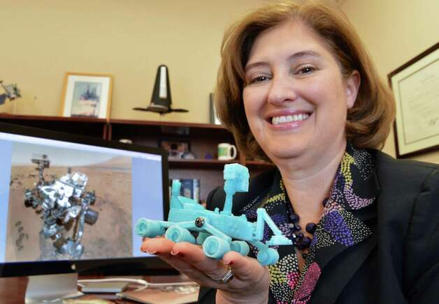 "Laurie A. Leshin, Dean of the School of Science, holds a scale model of the Mars Rover ""Curiosity,"" 3D printed for her by an RPI grad student at her office on the RPI campus Tuesday Jan. 8, 2012, in Troy, N.Y.  The NASA spacecraft  is currently exploring the surface of Mars.  (John Carl D'Annibale / Times Union) Photo: John Carl D'Annibale / 00020669A"