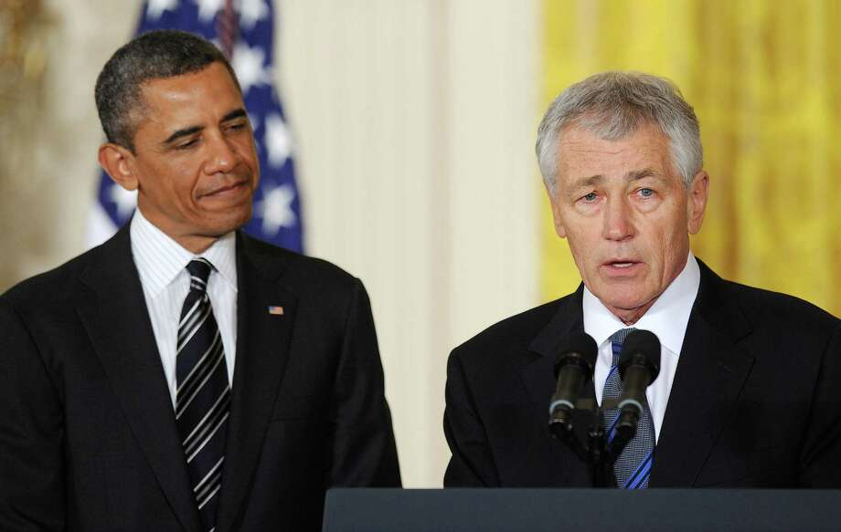 Former U.S. Sen. Chuck Hagel, right, a Republican from Nebraska, is nominated to be Secretary of Defense by President Obama. Photo: Olivier Douliery, MBR / Abaca Press