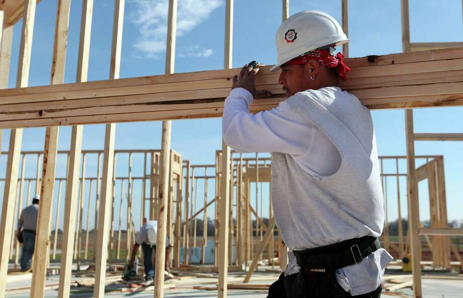 Richard Gonzales carries lumber while constructing a home in a Sugar Land subdivision. Metrostudy projects that housing starts in the Houston area will grow by about 17 percent this year, to as many as 27,500 homes. Photo: Mayra Beltran, Staff / © 2012 Houston Chronicle