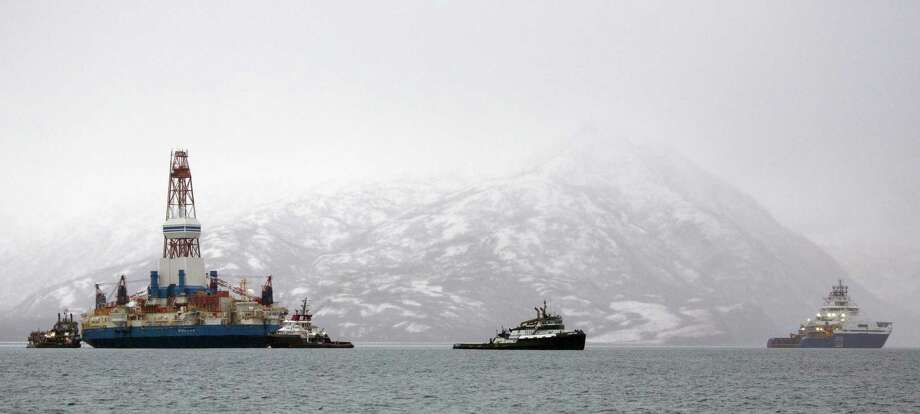 "Salvage teams conduct an assessment of Shell's Kulluk drill barge on January 9, 2013 in Kodiak Island's Kiliuda Bay in Alaska. An oil rig which ran aground in Alaska has been refloated and is being towed to a nearby harbor, with no signs of pollution seen, officials said on January 7. ""The Kulluk was refloated and the vessel condition assessed. The tow is now ongoing and the vessels are in Kiliuda Bay approaching the anchorage,"" said incident commander Sean Churchfield, Shell Alaska's operation manager.  AFP PHOTO / GREENPEACE / TIM AUBRYTIM AUBRY/AFP/Getty Images Photo: TIM AUBRY, Stringer / © Greenpeace / Tim Aubry"