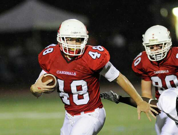 Greenwich High School running back Shane Nastahowski, # 48, breaks upfield during football game between Bassick High School of Bridgeport and Greenwich High School at Greenwich, Friday night, Sept. 23, 2011. Trailing play is Joe Kelly # 80 of Greenwich. Photo: Bob Luckey / Greenwich Time