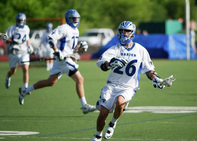 Darien's Peter Gesualdi moves the ball as Wilton and Darien High Schools face off in the Class M boys lacrosse semifinals at Brien McMahon in Norwalk, Conn., June 6, 2012.  Darien won to advance. Photo: Keelin Daly / Stamford Advocate
