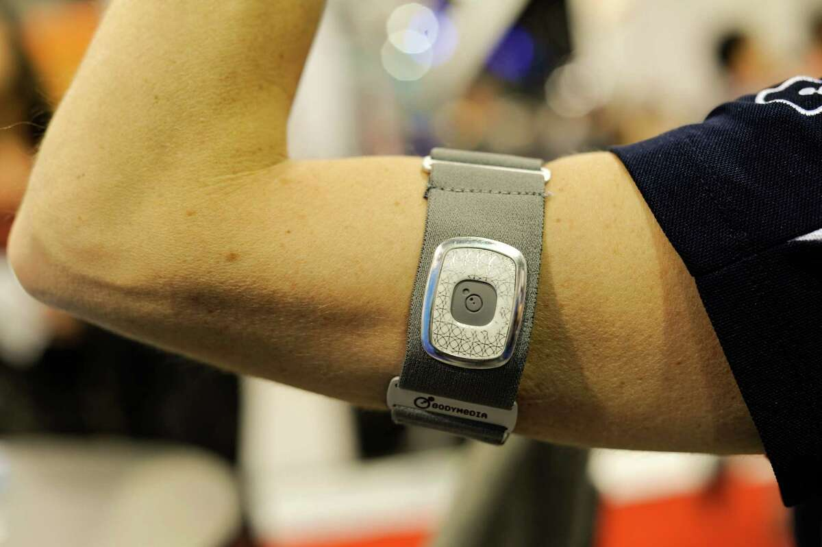 The BodyMedia Inc. Fitness Armband is arranged for a photograph during the 2013 Consumer Electronics Show in Las Vegas, Nevada, U.S., on Wednesday, Jan. 9, 2013. The 2013 CES trade show, which runs until Jan. 11, is the world's largest annual innovation event that offers an array of entrepreneur focused exhibits, events and conference sessions for technology entrepreneurs. Photographer: David Paul Morris/Bloomberg