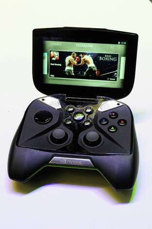 The Nvidia Corp. Shield gaming device is arranged for a photograph at the 2013 Consumer Electronics Show in Las Vegas, Nevada, U.S., on Wednesday, Jan. 9, 2013. The 2013 CES trade show, which runs until Jan. 11, is the world's largest annual innovation event that offers an array of entrepreneur focused exhibits, events and conference sessions for technology entrepreneurs. Photographer: David Paul Morris/Bloomberg Photo: David Paul Morris, Bloomberg / © 2013 Bloomberg Finance LP