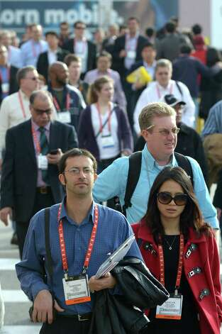 Consumers move between exhibition halls  at the 2013 International CES at the Las Vegas Convention Center on January 9, 2013 in Las Vegas, Nevada. CES, the world's largest annual consumer technology trade show, runs from January 8-11 and is expected to feature 3,100 exhibitors showing off their latest products and services to about 150,000 attendees.AFP PHOTO / JOE KLAMARJOE KLAMAR/AFP/Getty Images Photo: JOE KLAMAR, AFP/Getty Images / AFP