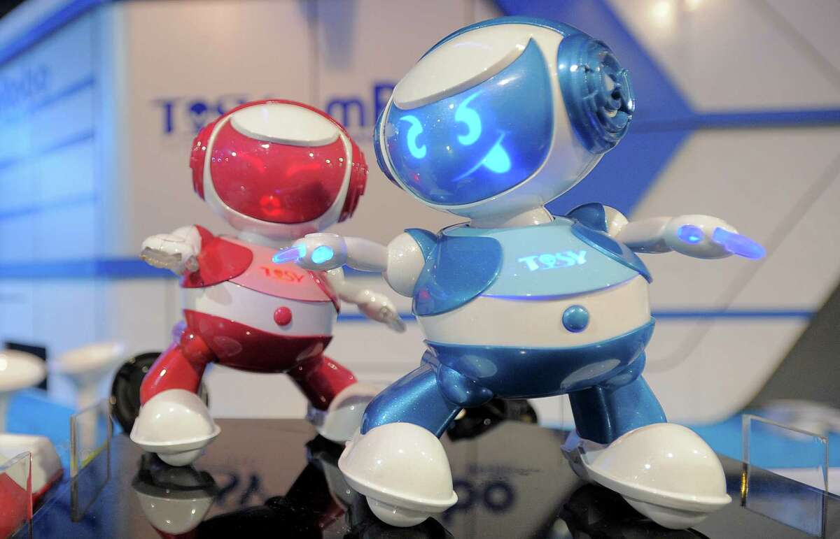Vietnam's Tosy Disco Robots are displayed at the 2013 International CES at the Las Vegas Convention Center on January 9, 2013 in Las Vegas, Nevada. CES, the world's largest annual consumer technology trade show, runs from January 8-11 and is expected to feature 3,100 exhibitors showing off their latest products and services to about 150,000 attendees.AFP PHOTO / JOE KLAMARJOE KLAMAR/AFP/Getty Images