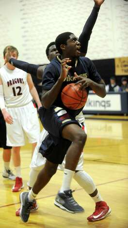 King's Guilbert Francois takes a shot against Greens Farms Academy during Thursday's game at King on January 10, 2013. Photo: Lindsay Perry / Stamford Advocate