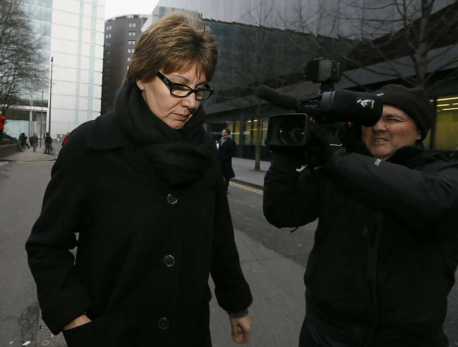 Detective Chief Inspector April Casburn of the London Metropolitan Police leaves Southwark Crown Court in London, Thursday, Jan. 10, 2013. Casburn has been found guilty of offering the now-defunct tabloid, The News of the World information about Operation Varec, the investigation into whether Scotland Yard's inquiry into phone hacking should be reopened. (AP Photo/Kirsty Wigglesworth) Photo: Kirsty Wigglesworth, Associated Press