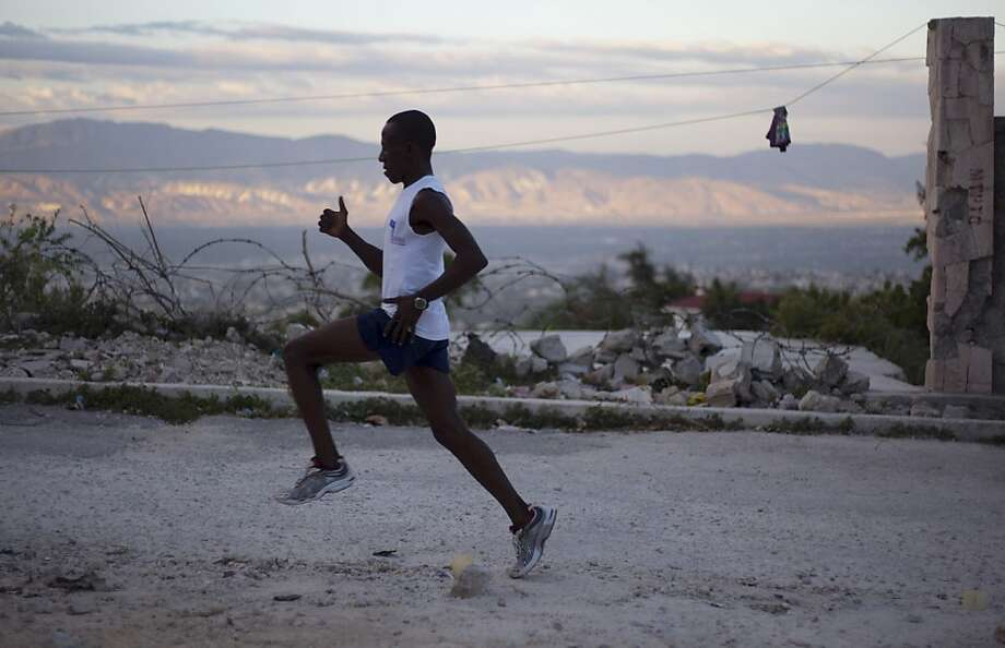 Astrel Clovis resumed running amid the ruins of Port-au-Prince a month after the 2010 quake in Haiti. Photo: Dieu Nalio Chery, Associated Press