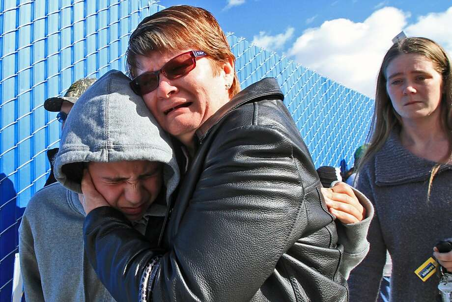 A family member weeps and hugs a student who emerged from Taft Union High School after the shooting. Photo: Irfan Khan, McClatchy-Tribune News Service