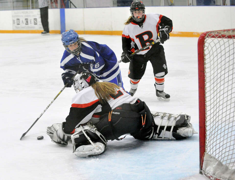 Darien's Marissa Baker shoots on Ridgefield goalie Heather Ogden during their game at the Ridgefield Winter Garden Arena on Thursday, Jan. 10, 2013. Darien won, 4-1. Photo: Jason Rearick / The News-Times