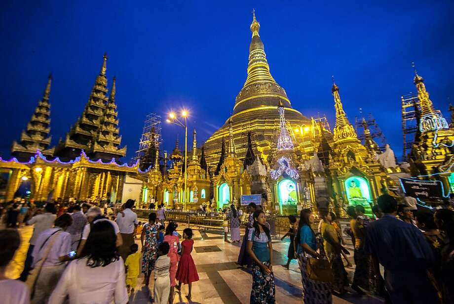 Crowds visit the Shwedagon Pagoda in Rangoon, Burma, last month. The once-isolated nation is slowly yielding to the pull of modern times. Photo: Richard Camp, Associated Press