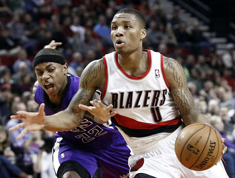 Damian Lillard, driving by Kings guard Isaiah Thomas in December, is the NBA's premier rookie. Photo: Don Ryan, Associated Press