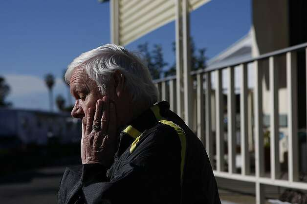 American Canyon resident, Philip Bensing, stands outside his mobile home where his elderly neighbor was allegedly murdered by her son, Dennis Stanworth, on January 10, 2013 in American Canyon, Calif. Dennis Stanworth was convicted in the 1960's of raping and murdering two teenage girls and was sentenced to death but eventually won parole. Photo: Sean Havey, The Chronicle