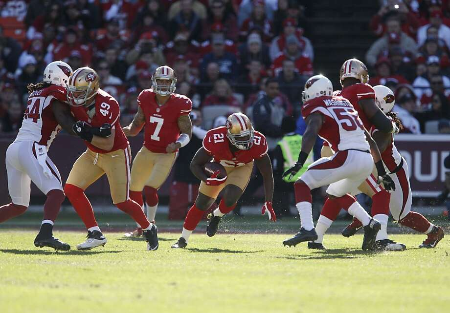 Frank Gore (21) still carries the ball through big holes, but his role is altered with Colin Kaepernick (7) at quarterback. Photo: Carlos Avila Gonzalez, The Chronicle