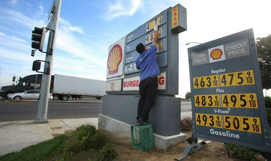 FILE- In this Friday, Oct. 5, 2012, file photo, Luis Cuevas changes the gas prices at the Shell station off California State Route 99. Forecasters say that ample oil supplies and weak U.S. gasoline demand will keep a lid on prices in 2103. The lows will be lower, the highs won't be so high, and the average price of a gallon of gasoline will fall 5 percent to $3.44, according to the Energy Department. (AP Photo/Gary Kazanjian, File) Photo: Gary Kazanjian