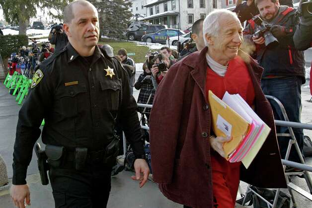 Former Penn State University assistant football coach Jerry Sandusky, right, arrives at the Centre County Courthouse for a post-sentence motion in Bellefonte, Pa., Thursday, Jan. 10, 2013. (AP Photo/Gene J. Puskar) Photo: Gene J. Puskar