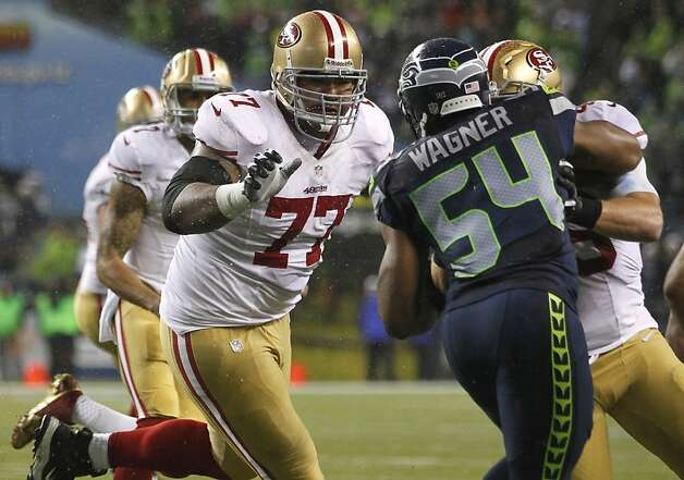 Pro Bowler Mike Iupati (left) is a big (330-pound) reason the 49ers' running game is successful. Photo: John Froschauer, Associated Press