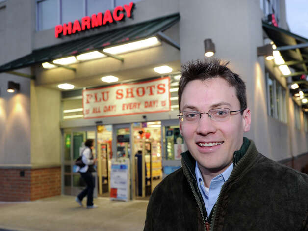 Greenwich resident Robert Wilson in front of the Walgreens Pharmacy in Old Greenwich, Wednesday, Jan. 9, 2013. Wilson said he received his flu shot at Walgreens after finding out two other pharmacies in town had run out of the vaccine. Photo: Bob Luckey / Greenwich Time