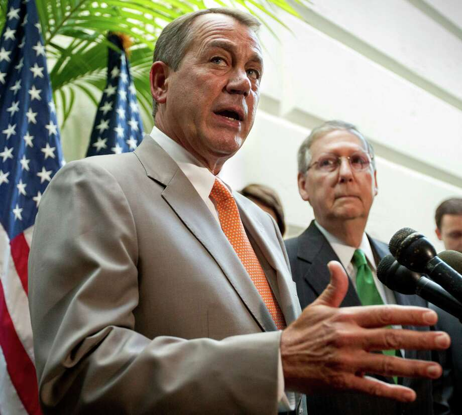 FILE - In this June 6, 2012, House Speaker John Boehner of Ohio, accompanied by Senate Minority Leader Mitch McConnell of Ky., right, gestures during a news conference on Capitol Hill in Washington. President Barack Obama had a clear political edge in his fight with Republicans over the fiscal cliff, and used it to his advantage. In the upcoming battle over federal borrowing and spending, the leverage will be more evenly divided and the outcome less predictable. In the fiscal cliff fight, Obama wanted to block automatic New Year's Day tax increases on everyone but the country's highest earners. Republicans were trying to protect upper-income people from those tax hikes, but eventually gave in because they didn't want to be blamed for the higher middle-class taxes that a stalemate would have triggered. Next come three deadlines that will almost certainly become entwined. The government will run out of cash in about two months and the Obama administration will need congressional approval to borrow more money or face a first-ever federal default, threatening global, economy-rattling consequences. Boehner and McConnell have said they won't agree to a debt-limit extension without an accord to cut spending. Just as adamantly, Obama says the government's debt ceiling must be raised and he won't negotiate over it, though he says he would bargain over spending cuts and tax increases to reduce federal deficits. (AP Photo/J. Scott Applewhite, File) Photo: J. Scott Applewhite