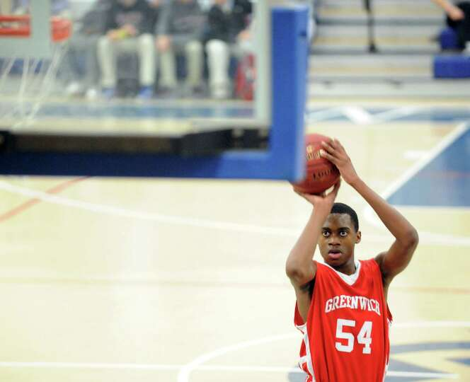Leonel Hyatt # 54 of Greenwich shoots a foul shout during boys high school basketball game between W