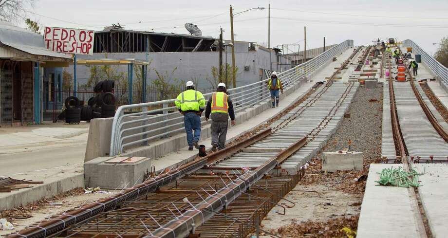 Construction continues on the North Line expansion of the  light rail around the North Main Bridge, Friday, Jan. 4, 2013, in Houston.  Businesses around the North Line expansion are bristling because the Main Street bridge is taking longer than predicted. One Mexican restaurant owner says his business is down about 40 percent as a result. HeâÄôs laid off workers and his wife is waiting tables. Metro is actually doing more than they have to, including $25,000 payments for lost business.( Karen Warren / Houston Chronicle )   Construction continues on the North Line expansion of the  light rail around the North Main Bridge, Friday, Jan. 4, 2013, in Houston.  Businesses around the North Line expansion are bristling because the Main Street bridge is taking longer than predicted. One Mexican restaurant owner says his business is down about 40 percent as a result. HeâÄôs laid off workers and his wife is waiting tables. Metro is actually doing more than they have to, including $25,000 payments for lost business.( Karen Warren / Houston Chronicle ) Photo: Karen Warren, Staff / © 2012 Houston Chronicle