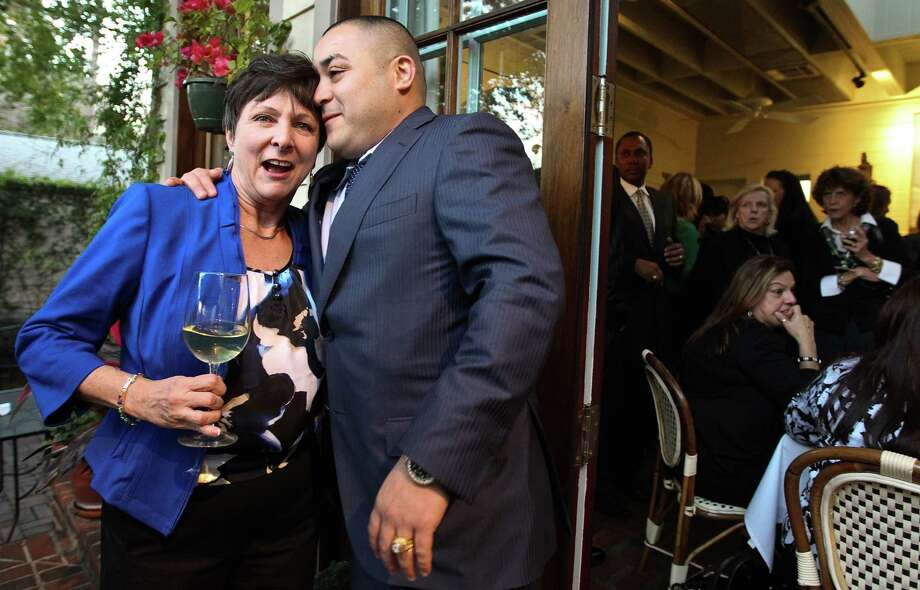 Retiring State District Judge Joan Campbell gets a hug and a kiss from Julio Ibarra during her farewell party Thursday at Houston's Back Street Cafe. Ibarra says Campbell saved his life in 2004 by giving him a second chance. Photo: Nick De La Torre, Staff / © 2013  Houston Chronicle